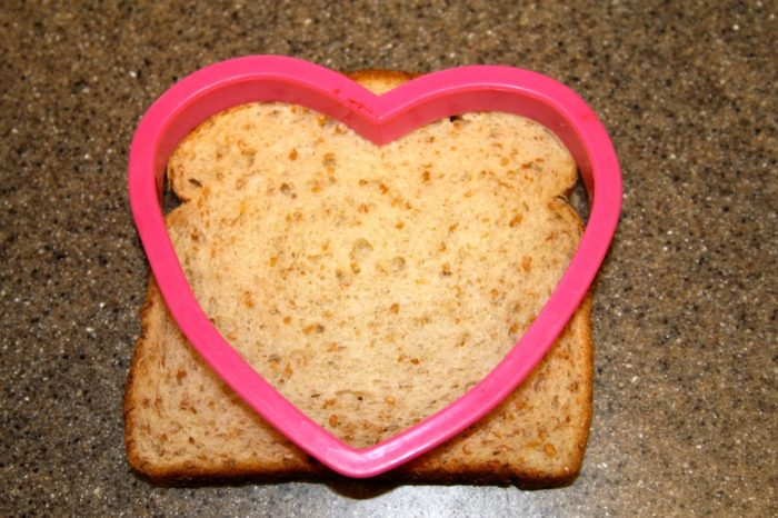 Place cookie cutter on a slice of bread