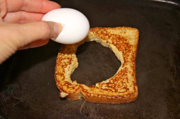 Dip the bread as above, when turned over, crack egg in the middle
