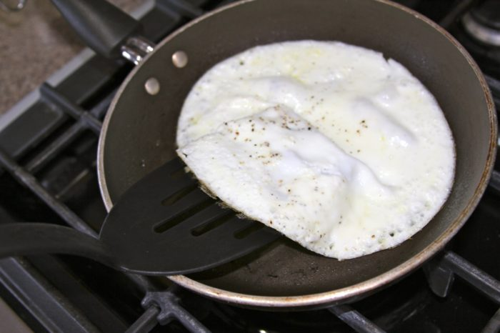 In a sprayed fry pan, cook egg whites 1 minute, turn, cook 1 addtional minute or until lightly browned. Set aside.