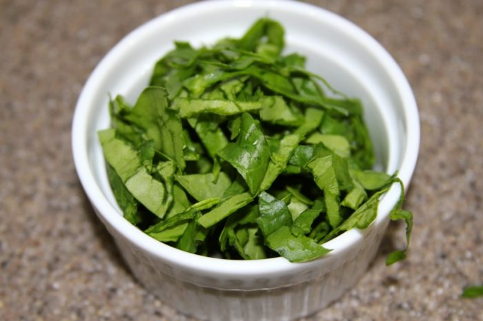 Thinly slice spinach