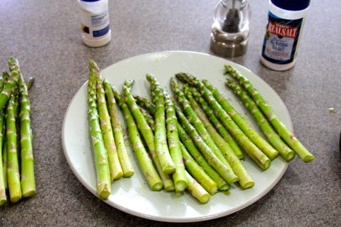 Lay asparagus on a plate or platter