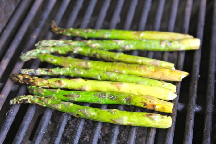 Lay aparagus on a cooking sprayed, heated grill. Rotate every 2 minutes until cooked thru