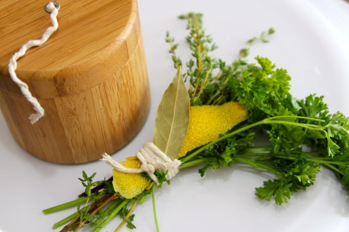 Bundle herbs together with kitchen twine
