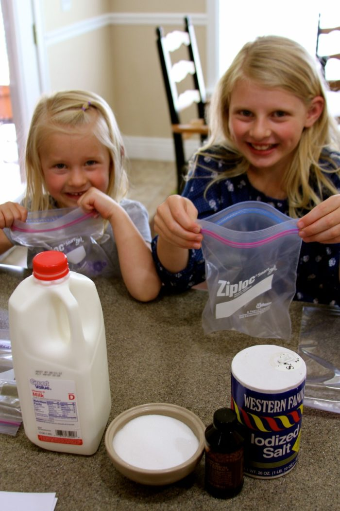 Kitchen helpers holding their baggies open for the ingredients!