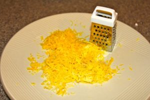 Finely grate 2 lemon peels to make lemon zest