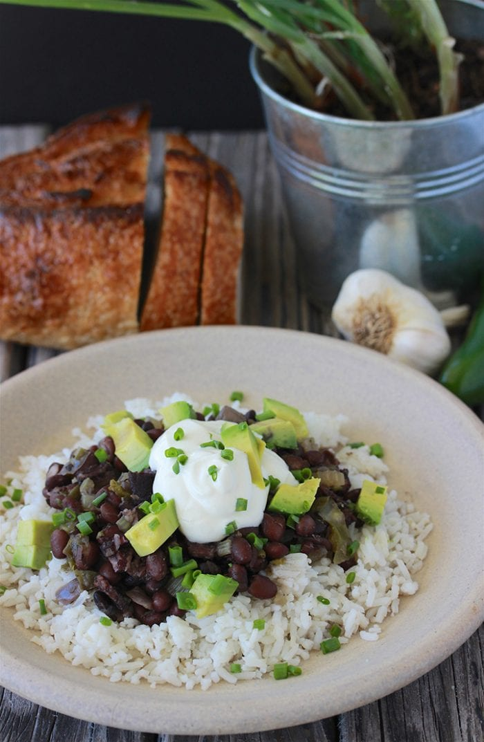 Our Southern Black Beans and Rice Recipe is one of those slow cooker recipes that you just keep coming back to--it's that good! by cookingwithruthie.com