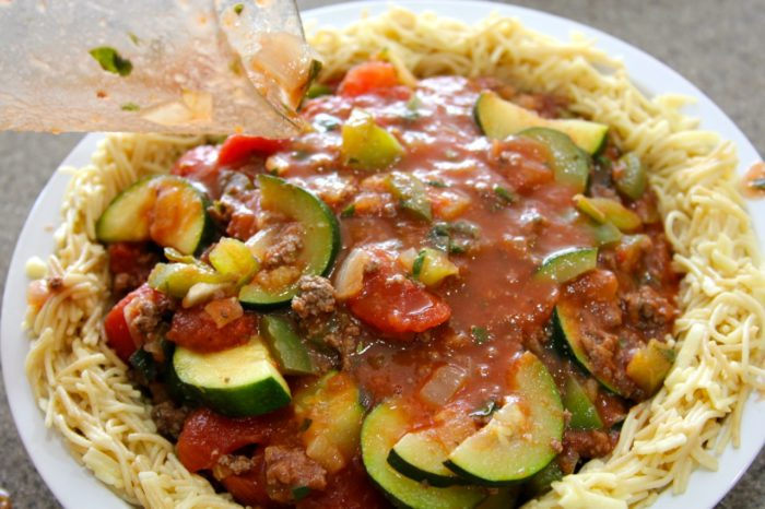 Pour sauce into noodle crust and bake as directed