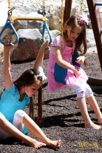 Little girls on swings