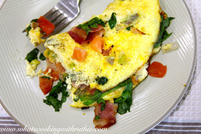 Today's Spinach and Bacon Omelette Recipe is the perfect way to enjoy the weekend! by cookingwithruthie.com