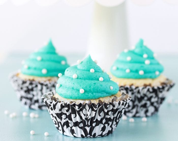 Our Tiffany Blue and Vanilla Cupcakes Recipe are a deliciously beautiful way to celebrate any occasion! by cookingwithruthie.com