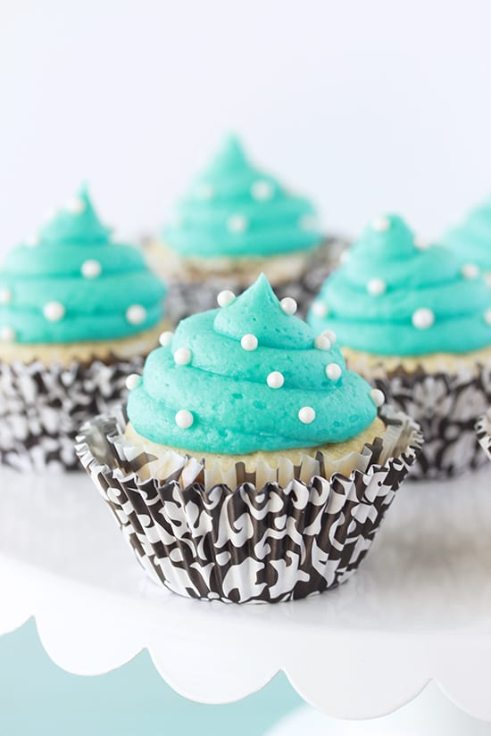 Our Tiffany Blue and Vanilla Cupcakes Recipe are a deliciously beautiful way to celebrate any special occasion! by cookingwithruthie.com