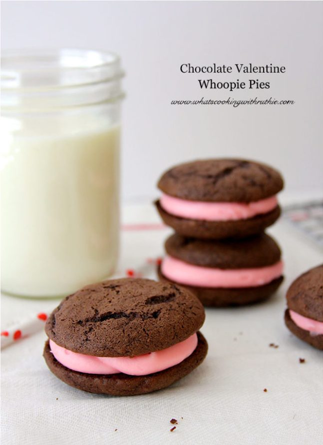 Chocolate Valentines Whoopie Pies Recipe are moist and chocolatey with a pink cream cheese filing which is perfect for giving to your Valentines! by cookingwithruthie.com
