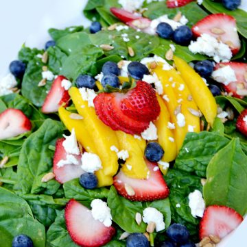 Mango Berry Salad by www.thehappygal.com on www.whatscookingwithruthie.com