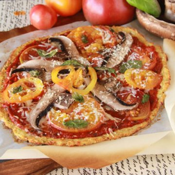 Gluten-free Cauliflower Pizza Crust will knock your socks off! YUM! by www.cookingwithruthie.com