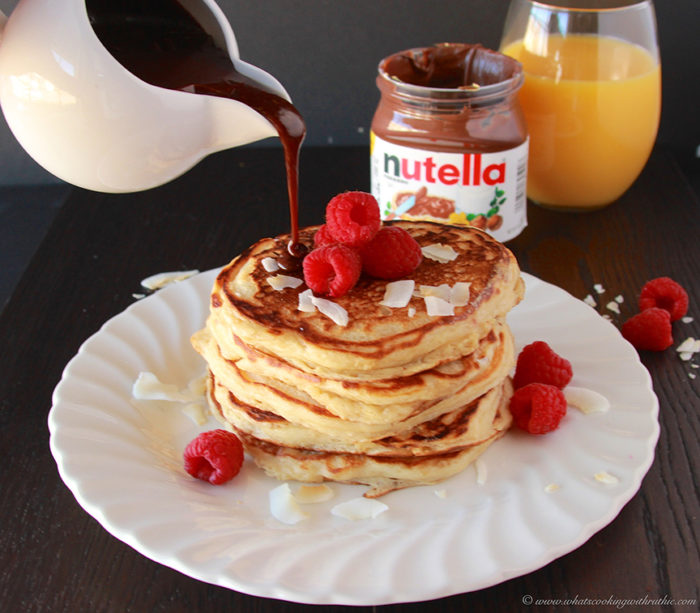 Toasted Coconut Pancakes with Nutella® Syrup in honor of International Pancake Day! www.cookingwithruthie.com