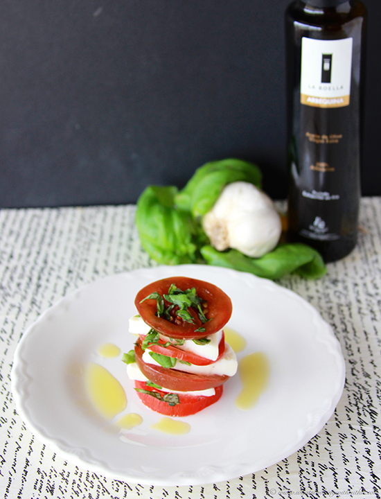 Stacked Caprese Salad on www.cookingwithruthie.com is a beautiful salad for any occasion!