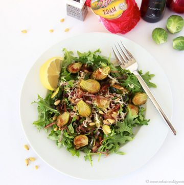 Roasted Brussel Sprout, Red Onion, Pine Nut Salad with Lemon Vinaigrette on www.cookingwithruthie.com is a savory salad that makes a deliciously healthy meal!