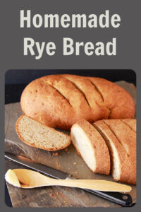 Our Homemade Rye Bread Recipe has a gentle rye flavor that's beautifully delicate–it's sure to be enjoyed! Today's rye bread recipe is mild in flavor because it uses two varieties of flour; both rye flour and all-purpose flour which makes it tasty enough enough for even the non-rye bread lovers out there. Our homemade Rye bread is simple to make in your kitchen and tastes SO much better than the store bought version! || cookingwithruthie.com #breadrecipe #homemadebread