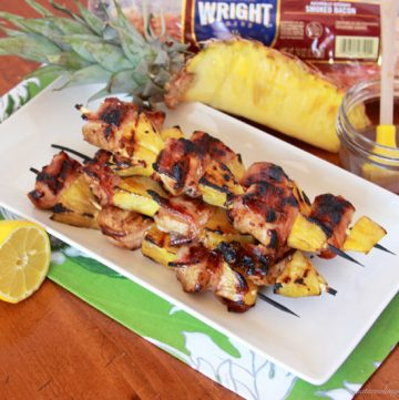 Bacon Wrapped Chicken Pineapple Skewers on www.cookingwithruthie.com are a must have for this summer!