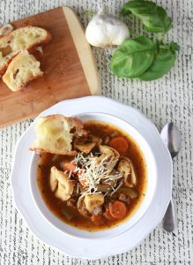 Italian Tortellini Soup by www.cookingwithruthie.com will keep you comfy cozy during the colder months!