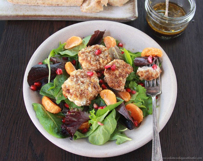 Our Baked Goat Cheese & Pomegranate Salad with Orange Balsamic Vinaigrette Recipe is flavorful, beautiful, and nutritious which are all healthy wins during the holidays! by cookingwithruthie.com