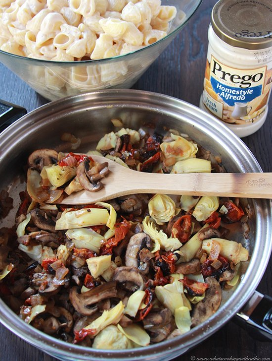 Sundried Tomato, Artichoke, Mushroom Alfredo Pasta on www.cookingwithruthie.com is a simple savory dinner the whole family will love! #pregosauce #spon