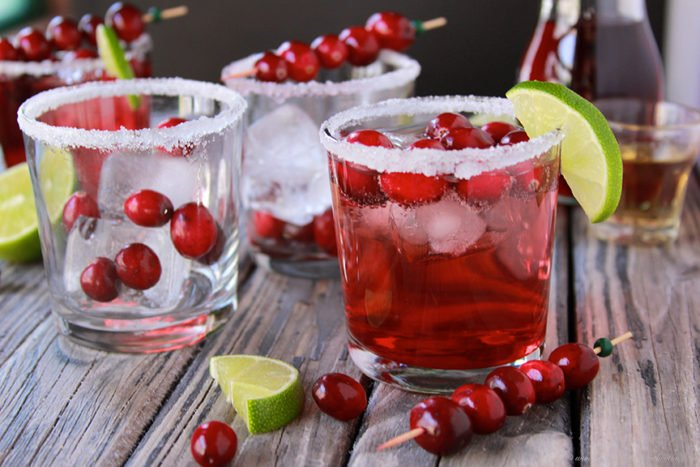 Our Cranberry Lime Margaritas Recipe are the perfect sparkling addition to your holiday party! by cookingwithruthie.com
