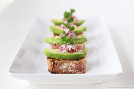 Avocado Toasts with Red Onion Relish on www.cookingwithruthie.com are a simple to make appetizer for any occasion!