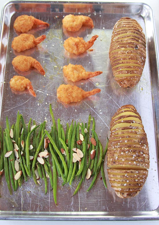 Butterfly Shrimp, Hasselback Potatoes, and Almond Green Beans on www.cookingwithruthie.com is a quick and delicious dinner!
