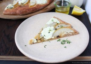 Pear, Thyme, and Ricotta Pizza on www.cookingwithruthie.com is a beautiful combination of flavors that will absolutely melt in your mouth!