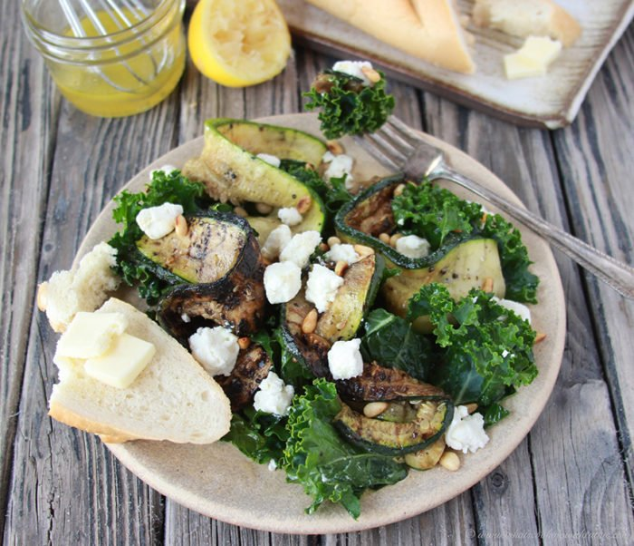 Charred Zucchini, Chevre, and Kale Salad with Lemon Vinaigrette on www.cookingwithruthie.com is a robust combinations of flavor that'll impress the whole family!
