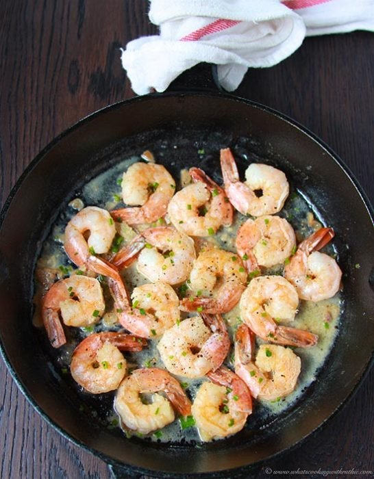 Garlic Chive Shrimp on www.cookingwithruthie.com is a light and delicious dinner that's super quick and easy to make!