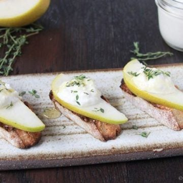 Pear, Ricotta, and Honey Crostini on www.cookingwithruthie.com are the perfect appetizer for all your festivities!
