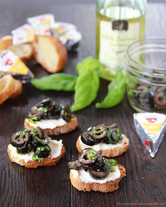 Basil Olive Tapenade Crostini's on www.cookingwithruthie.com a beautiful combination of flavors to start off any party!