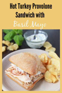 Our Hot Turkey Provolone Sandwich with Basil Mayo Recipe tastes like your favorite deli sandwich that is so simple to make at home! Oh and we can not forget the Basil Mayo! I like to use olive oil mayonnaise then add the finely sliced fresh basil leaves, some salt and pepper, and a splash of fresh lemon juice! You've simply gotta make one to enjoy with me. || cookingwithruthie.com #turkeysandwich #basilmayo #simpleanddelicious