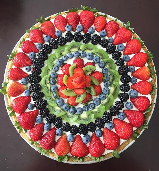 Today's Fruit and Cream Cookie Pizza Recipe is a sugar cookie crust topped with a cream cheese, whipped cream filling, and topped with fresh fruit! by cookingwithruthie.com