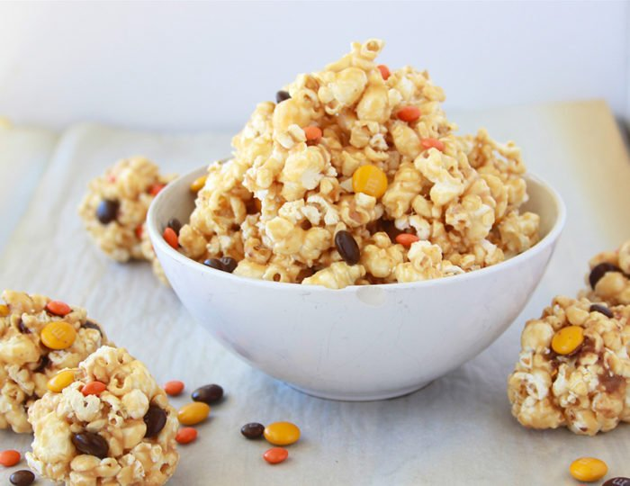 Our Halloween Caramel Corn Recipe makes fabulous popcorn balls or just enjoy it by the handful too! by cookingwithruthie.com