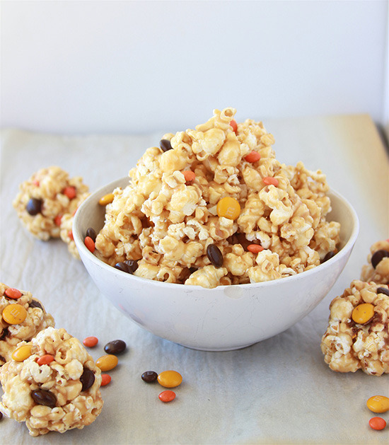 Halloween Caramel Corn on www.cookingwithruthie.com make popcorn balls or just eat it by the handful! Caramel Corn and M&M's are meant to go together!