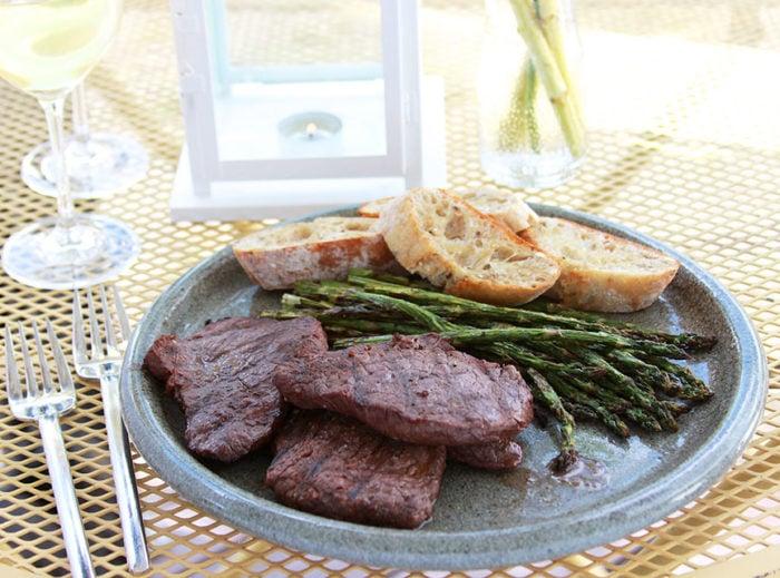 Grilled Red Wine Elk Steak is a flavorful marinade for elk or beef steak! www.cookingwithruthie.com