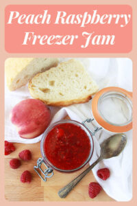Peach Raspberry Freezer Jam Recipe is going to be your new family favorite! Freezer jam is such a lovely way to preserve fruit because without the heat from bottling it is able to keep it's fresh flavor! Our recipe is made with some peaches, raspberries, lemon juice and something more. #jamrecipe #freezerjam #peachjam