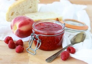 Peach Raspberry Freezer Jam is going to be your new family favorite! www.cookingwithruthie.com