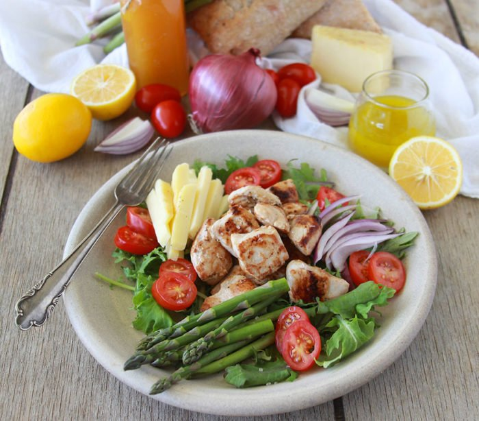 Chicken, Asparagus, Tomato Salad with Meyer Lemon Vinaigrette is not your average salad... it's SO good! www.cookingwithruthie.com