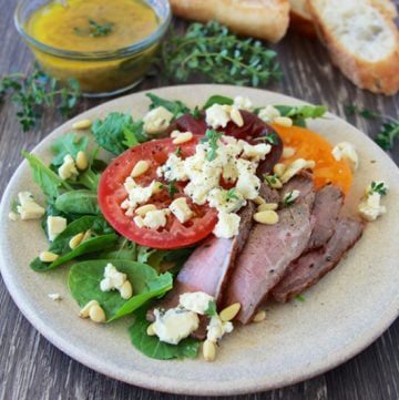 Heirloom Tomato, Steak, Blue Cheese Salad is a hearty salad that'll keep you full and happy for hours! www.cookingwithruthie.com