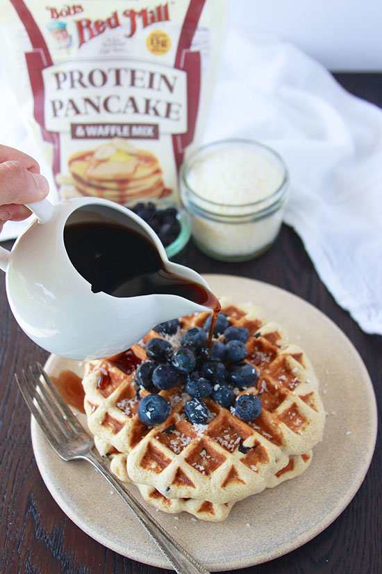 Blueberry Coconut Protein Waffles with Blueberry Syrup will jump start your morning in a healthy way! @bobsredmill #spon www.cookingwithruthie.com