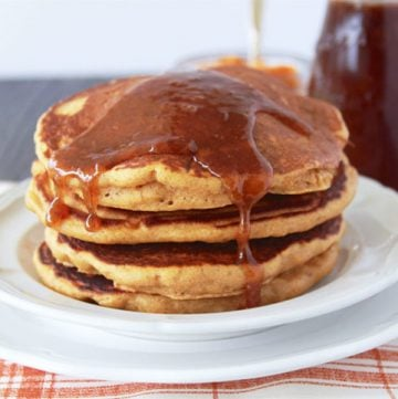Pumpkin Pancakes with Cinnamon Caramel Syrup is an autumn delight! You're family will LOVE them! www.cookingwithruthie.com