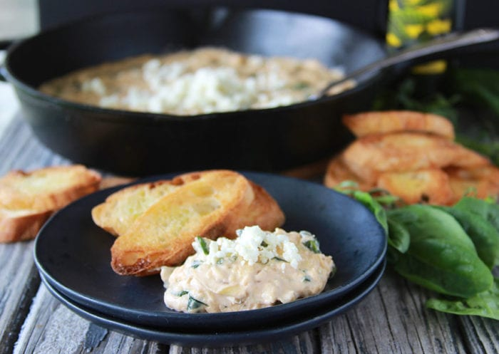 Spinach Artichoke Dip with Crostini's is always welcome at any gathering! www.cookingwithruthie.com