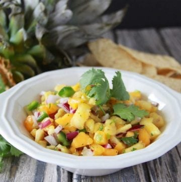Papaya Pineapple Salsa is a must-make for your for Cinco de Mayo Fiesta this year! www.cookingwithruthie.com