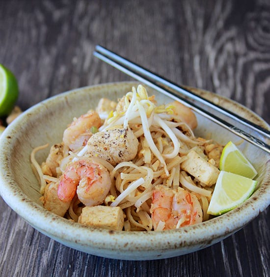 Chicken, Shrimp, and Tofu Pad Thai is SO simple to make at home and tastes better than any take-out! www.cookingwithruthie.com