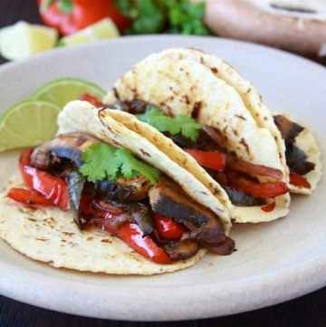 Portabella Mushroom Fajitas are flavorful veggie dinner that the whole family will love- feel free to add your favorite protein too! www.cookingwithruthie.com