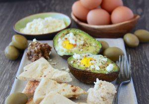Mediterranean Baked Eggs in Avocado make breakfast Egg-xtra special! #HappyHenHappyEgg #FreeestFreeRange #AD